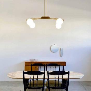 Araña de luces de hierro hecha a mano con acabado de latón y vidrio Made in Italy - Grinta
