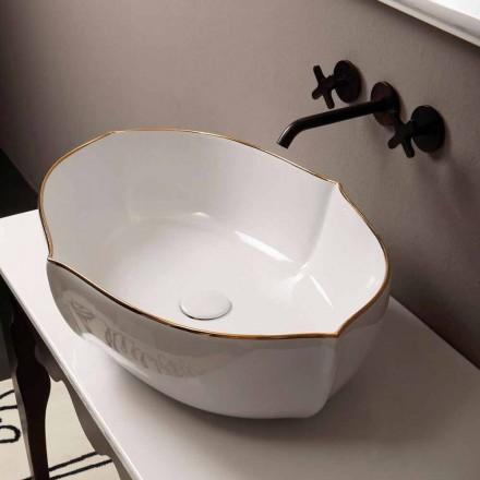 Lavabo sobre encimera de cerámica de diseño en oro blanco realizado en Italia Oscar