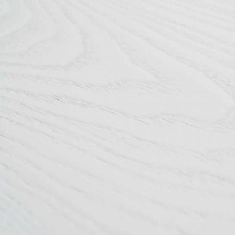 Mesa extensible blanca con estructura en sólido natural. Rico.
