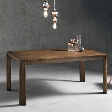 Mesa extensible moderna con patas de trapecio en madera de fresno de Parre